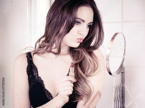 canvas print picture Beautiful woman with lipstick in bathroom.