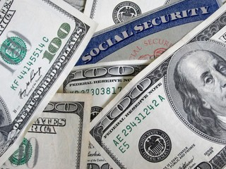 social security card buried in money