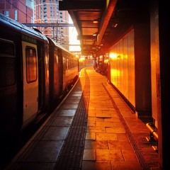 sun setting on train platform