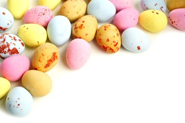 Chocolate candy Easter egg border on a white background