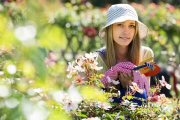 Female florist in the garden