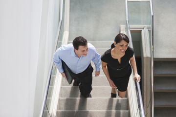 Colleagues walking on stairway in office building