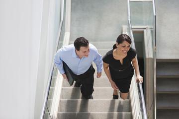 Colleagues walking on stairway in office building