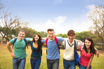 Happy group of students walking together