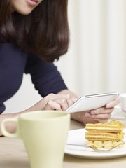 woman using cellphone while taking a coffee break