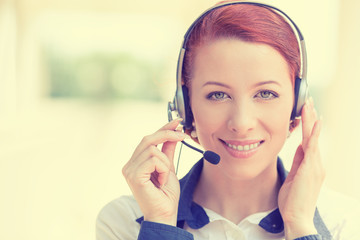 Customer service representative wearing headset at office