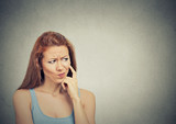 Fototapety thoughtful skeptical suspicious young woman grey background