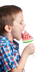 Little boy eating a lollipop watermelon