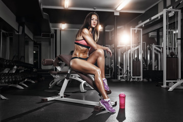 fitness girl with shaker posing on bench in the gym © Fotokvadrat
