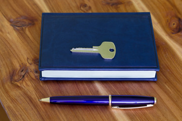 Note Pad, Pen and key.