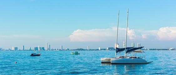 Sailboats anchored on Pattaya City background