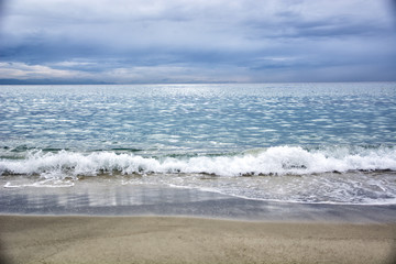Dramatic view of sea or ocean in a cloudy day with waves