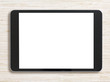 Black tablet pc or ipad on bleached wood background - 77921900