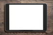 Black tablet pc on old wood background - 77921909