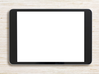 Black tablet pc on bleached wood background