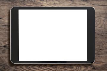 Black tablet pc on old wood background