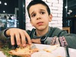 Child eat in fast food restaurant. Do not like the food