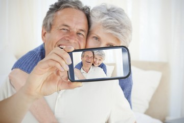 Couple taking selfie on smartphone