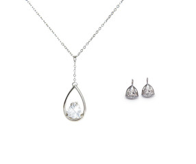 beautiful silver necklace and diamond earrings isolated on white