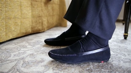 Man in white shirt and tie wearing the stylish shoes