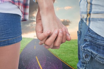 Couple in check shirts and denim holding hands