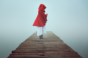 Dark little red riding hood in the mist