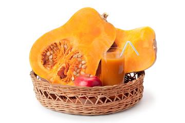 pumpkin, pumpkin juice and apple arranged in a basket