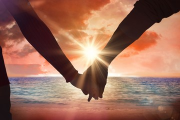 Composite image of couple holding hands rear view