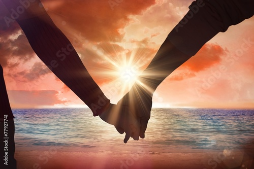 Staande foto Water Composite image of couple holding hands rear view