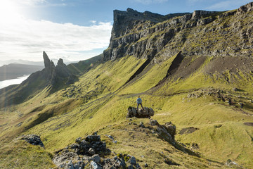 Man conquering Scottish highland landscape