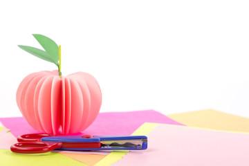 paper pink apple on color background