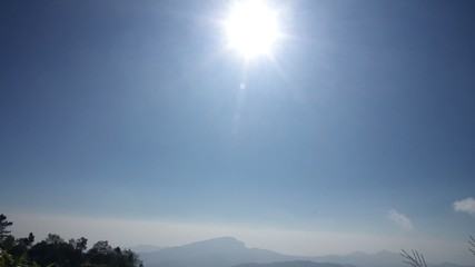 footage of cloud movement over mountain with sun rise