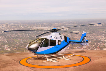 helicopter parking on building roof top use for commercial air t