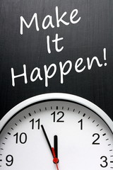 The phrase Make It Happen on a blackboard with a clock