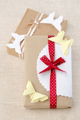 origami butterfly on a box with a gift