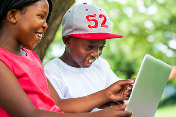 African youngsters enjoying time with laptop.
