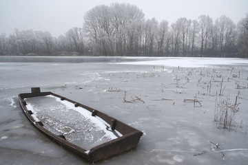 The boat trapped in the frozen lake