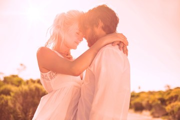 Attractive couple embracing by the road