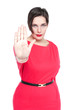 Beautiful plus size woman making stop sign gesture isolated. Foc