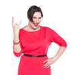 Beautiful plus size woman in red dress with horn gesture isolate
