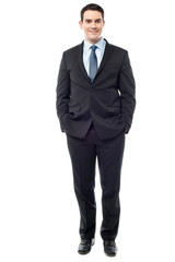 Confident businessman posing over white