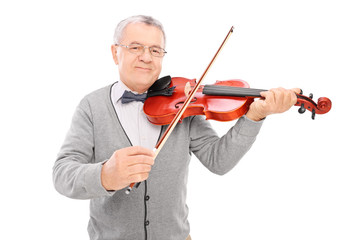 Cheerful mature man playing a violin