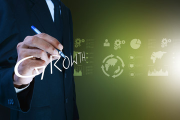 business man writing growth concept