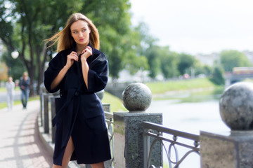 Beautiful brown-haired woman in a black coat
