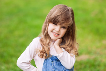 Funny little girl on a green background
