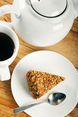 piece of cake and cup of coffee on wooden table