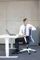 yoga in office. business man exercising on armchair