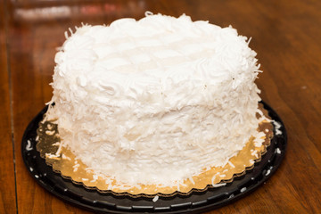 Whole Coconut Cake on Wood Table