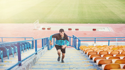 sportsman doing speed exercise on stairs on the stadium