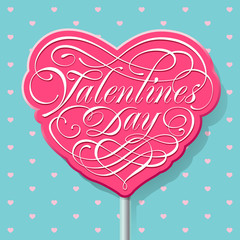 Valentine calligraphic lettering on a pink lollipop